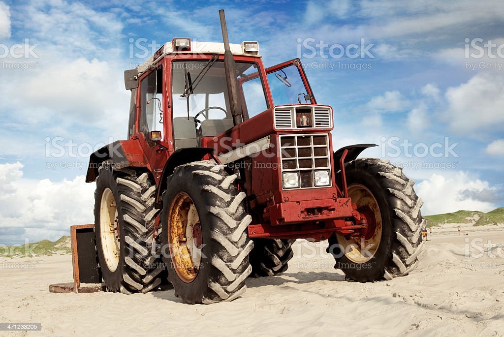 Tractor on a beach royalty-free stock photo