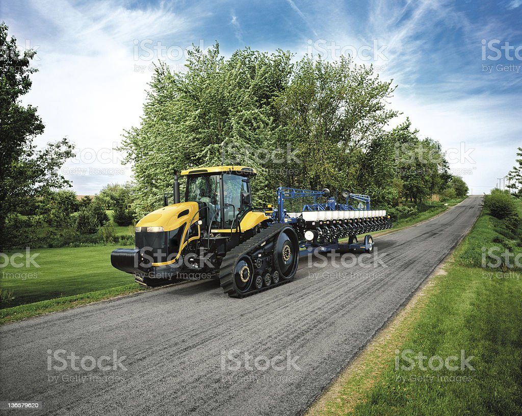 Tractor on a country raod. stock photo