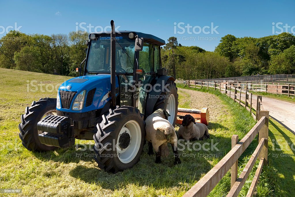 Tractor on a farm royalty-free stock photo