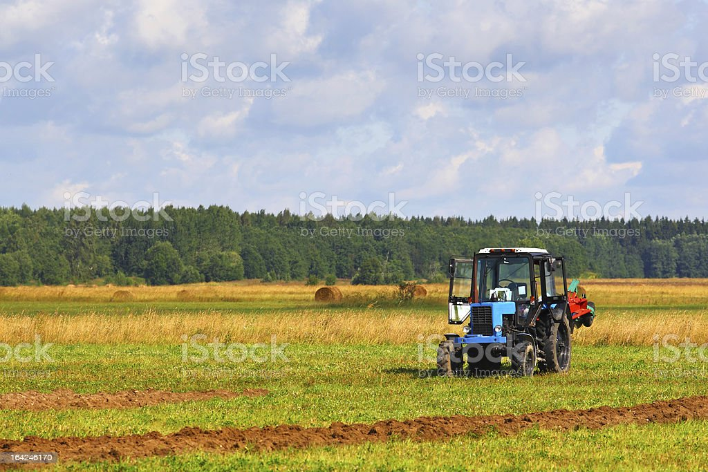 Tractor on a farmer field royalty-free stock photo