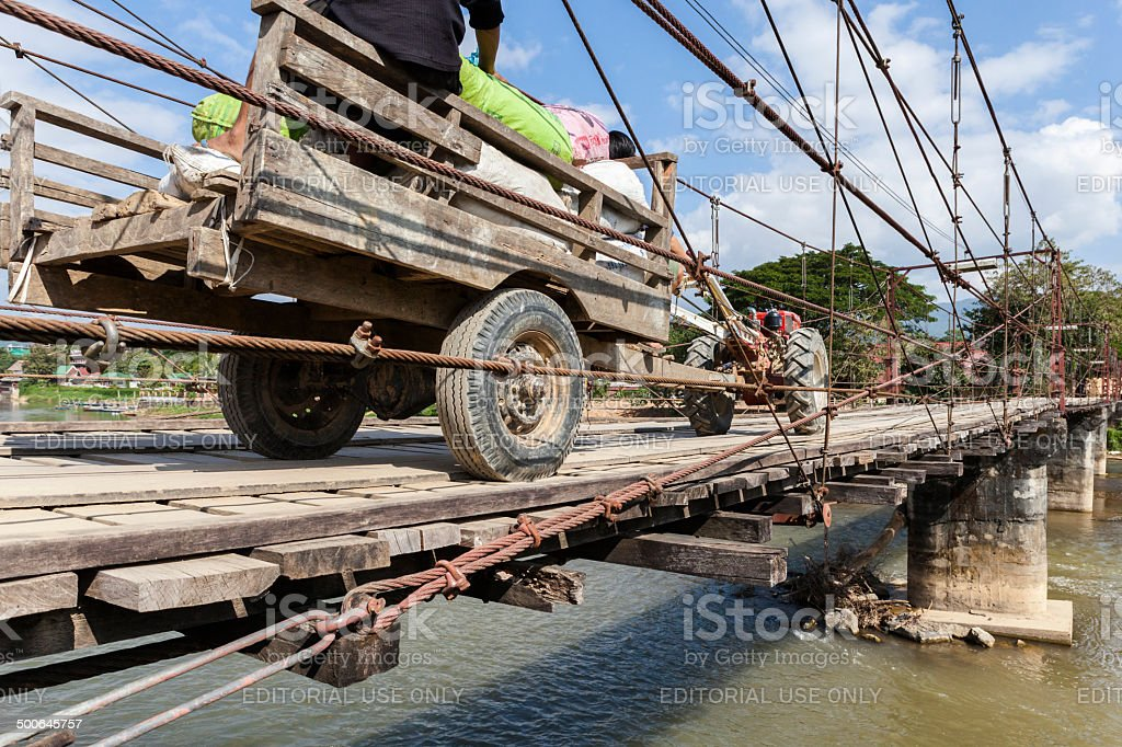 Tractor on a wooden bridge in Vang Vieng stock photo