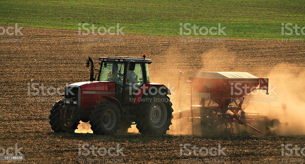 Tractor on Dusty Field royalty-free stock photo