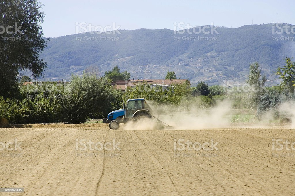 Tractor on farm stock photo