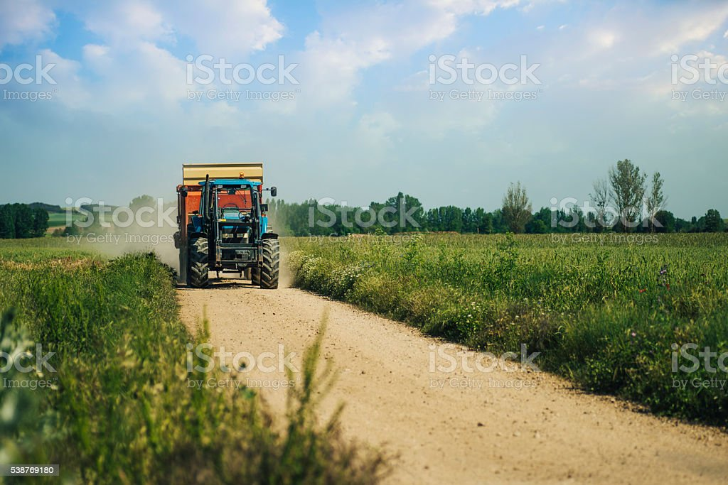 Tractor on field stock photo
