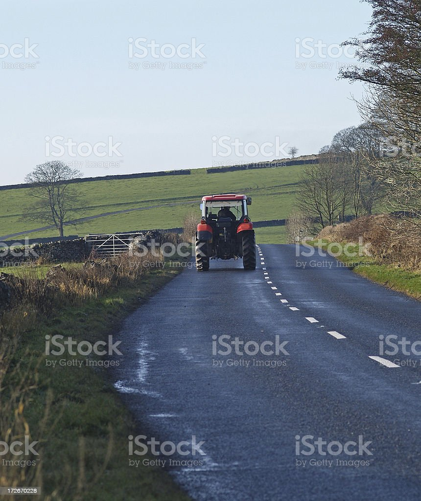 Tractor on rural Road stock photo