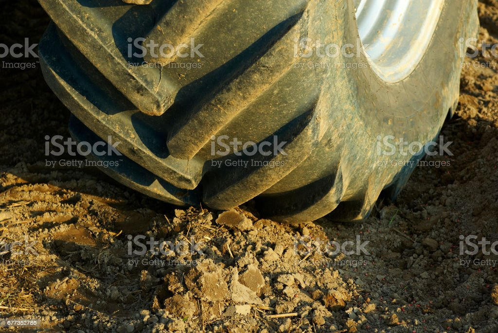 Tractor on the field cultivating and preparing arable land stock photo