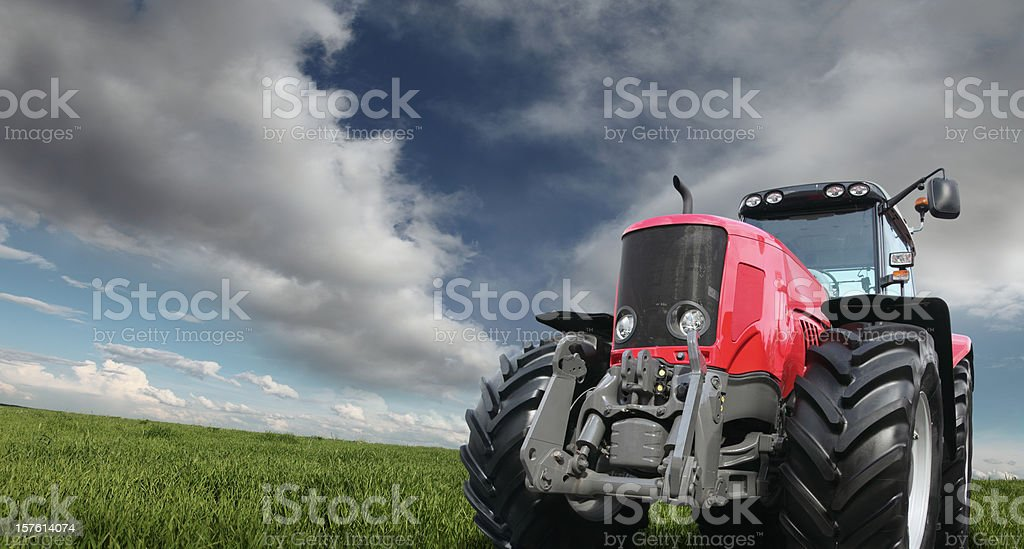 Tractor on the Green Field royalty-free stock photo