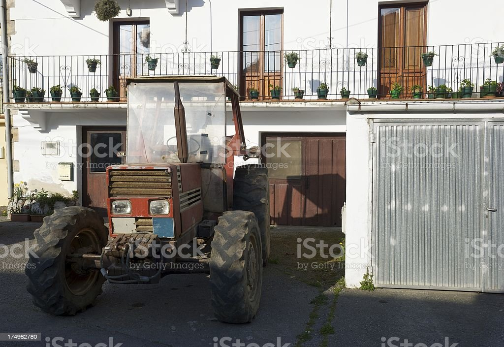 Tractor parked in the farm stock photo