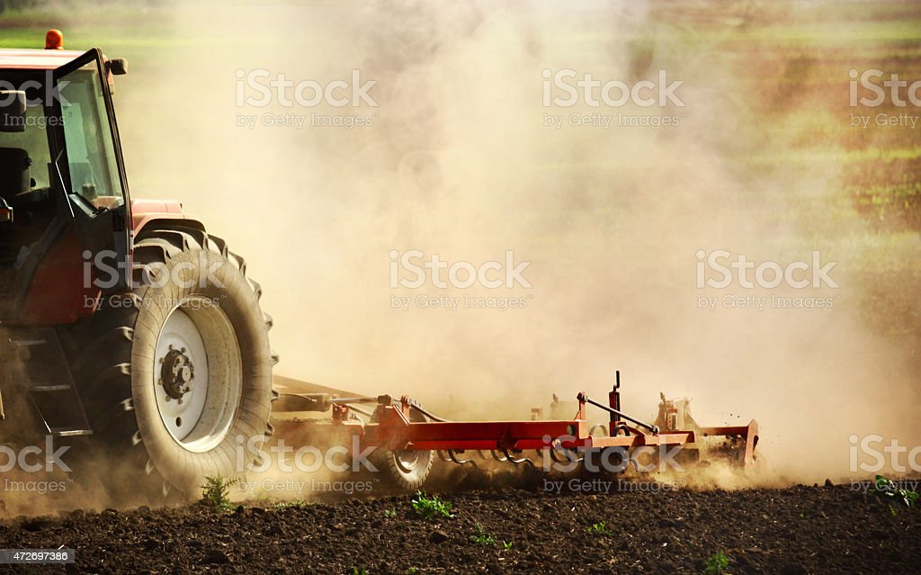 Tractor performing fine cultivation. stock photo