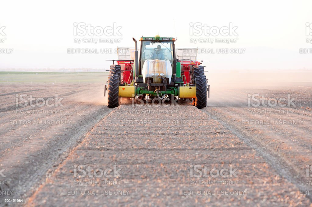 Tractor planting stock photo