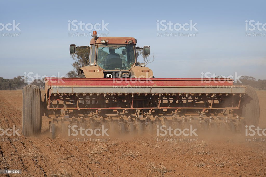 Tractor planting seed royalty-free stock photo