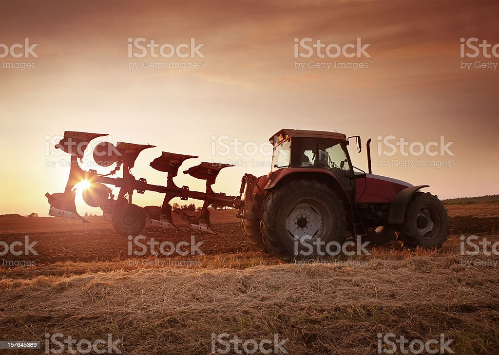 Tractor Ploughing on the Field royalty-free stock photo