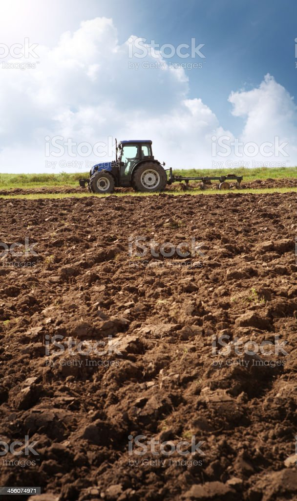 Tractor Ploughing on the Field stock photo