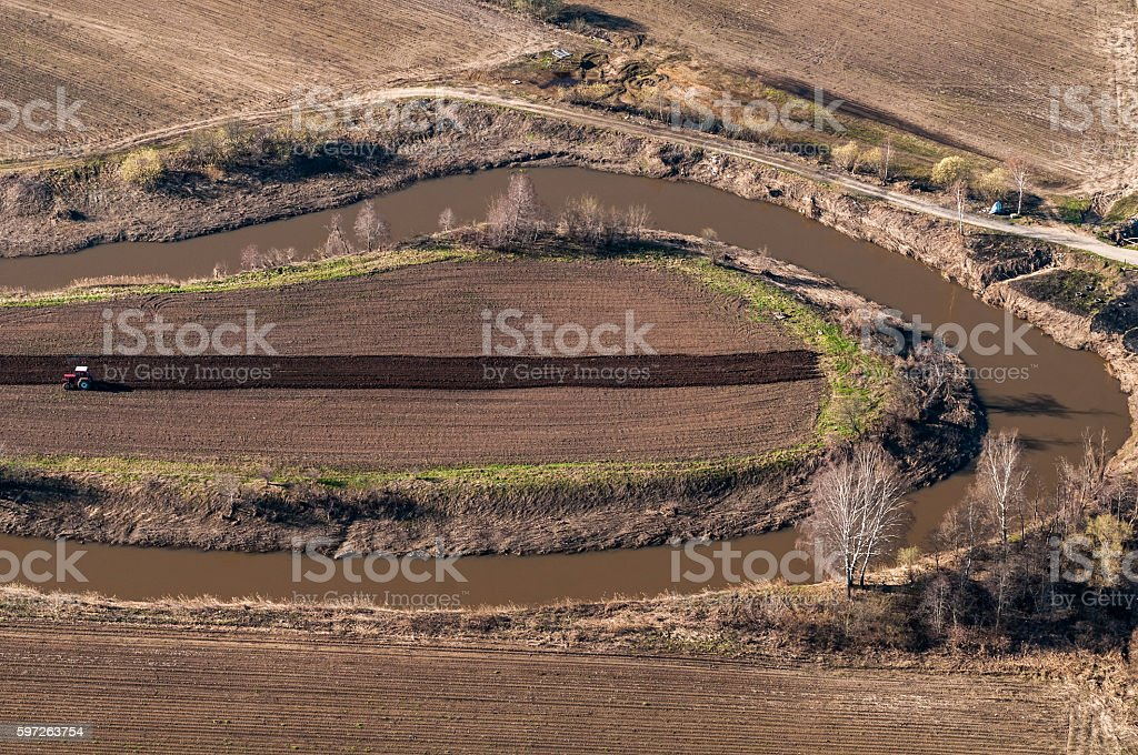 Tractor plowing a farm field stock photo