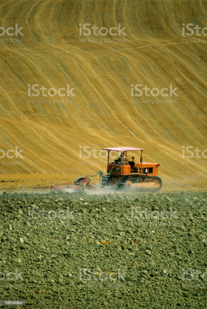 Tractor Plowing Golden Field royalty-free stock photo