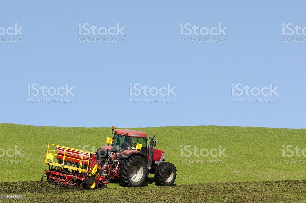 Tractor plowing the ground stock photo