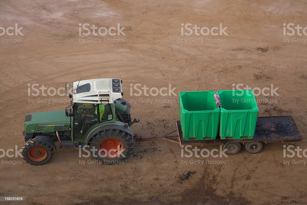 Tractor pulling empty grape bins during harvest at a winery royalty-free stock photo