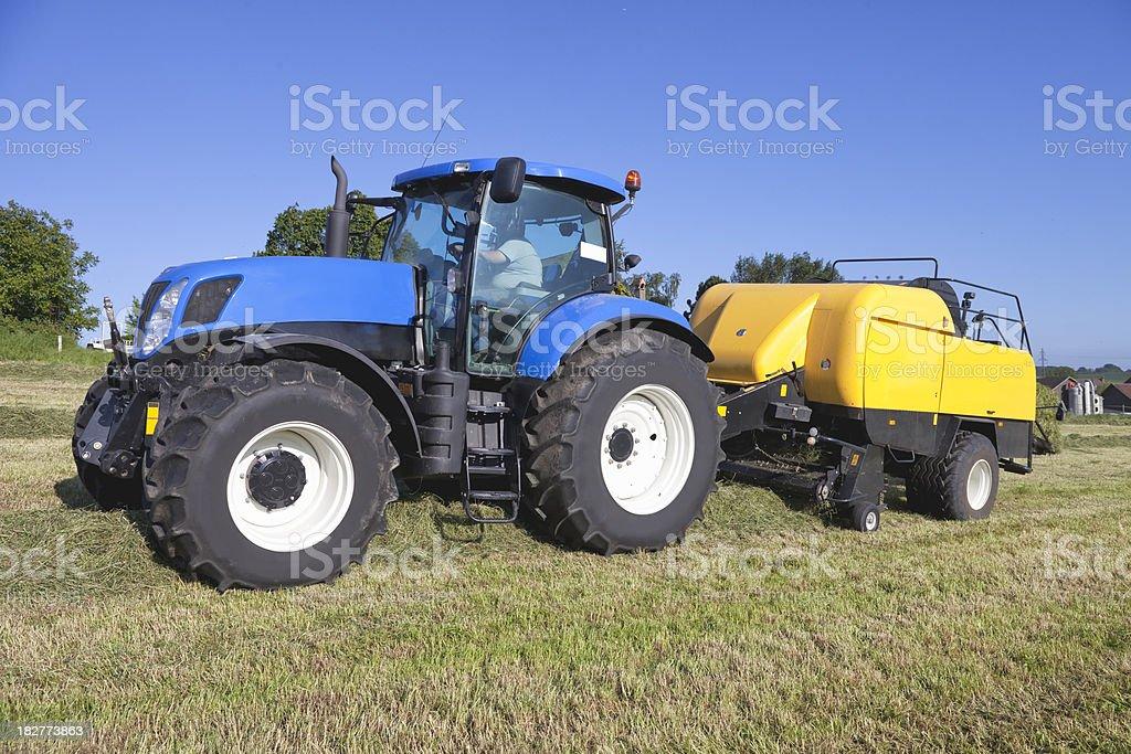 Tractor Pulling Hay Baler, Switzerland, Vaud, Summer Evening stock photo