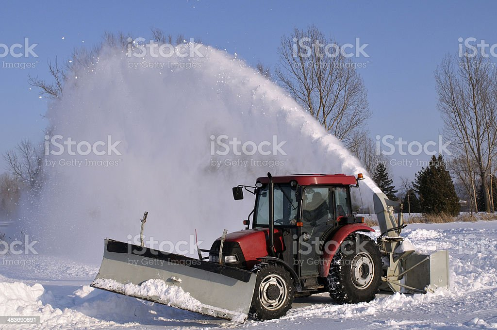 Tractor  snow blower stock photo