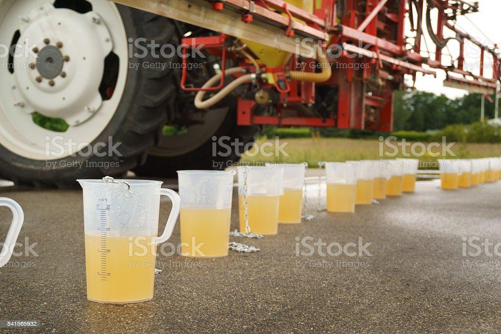Tractor spray nozzle adjustment stock photo