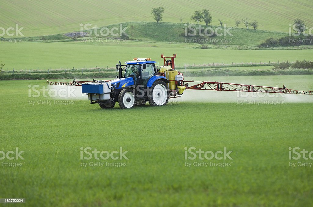 Tractor spraying field royalty-free stock photo