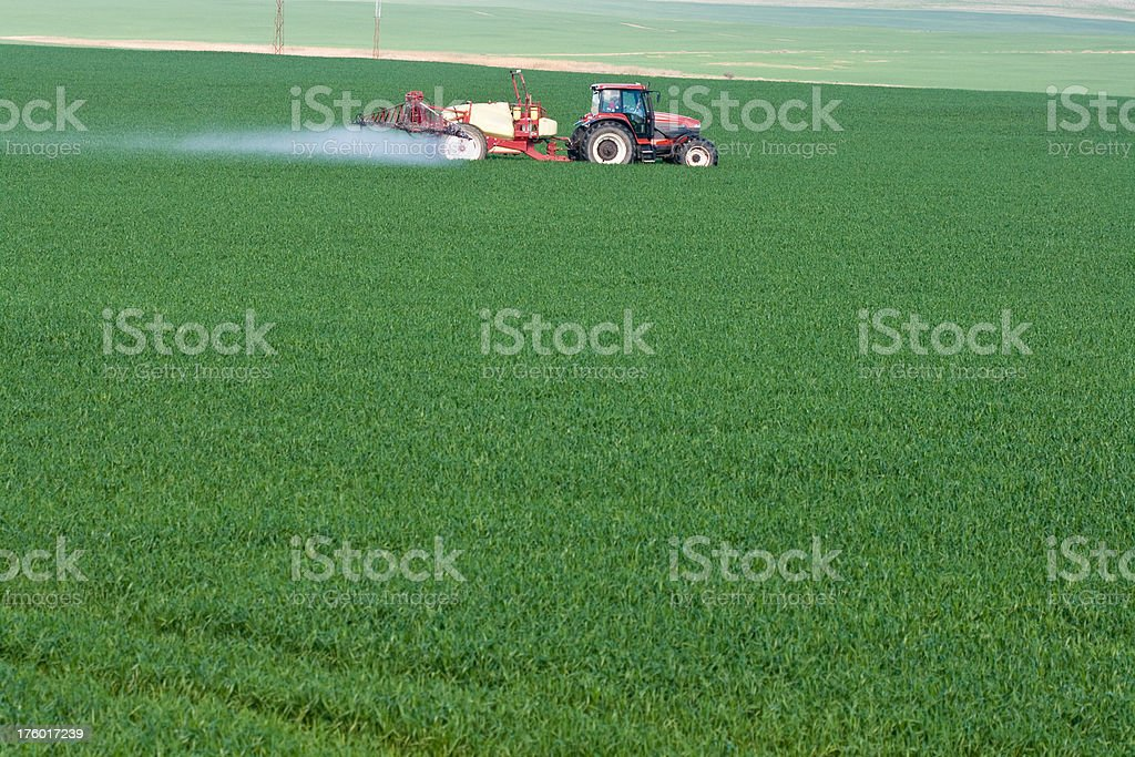 tractor spraying green crops royalty-free stock photo