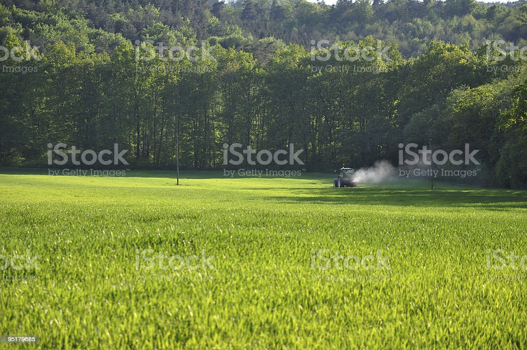 Tractor Spraying Pesticide royalty-free stock photo
