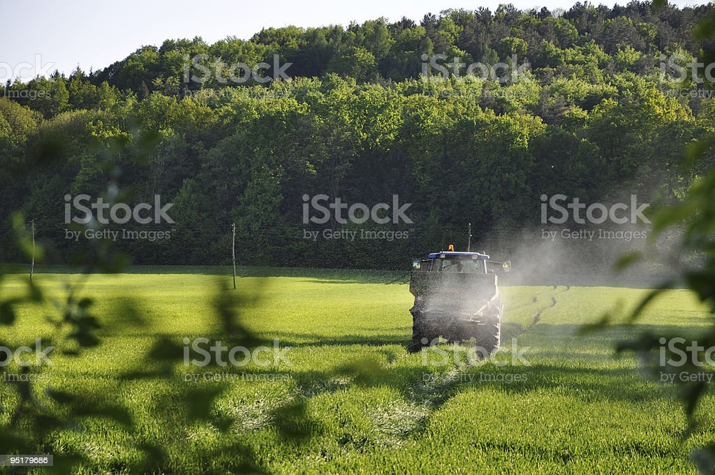 Tractor Spraying Pesticide stock photo