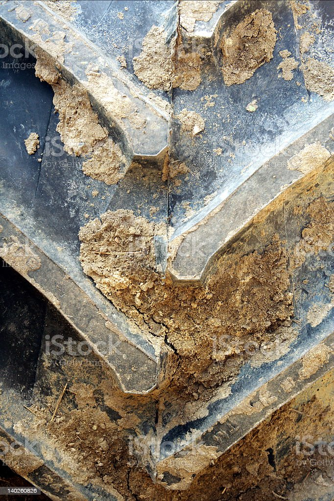 Tractor tire with mud royalty-free stock photo