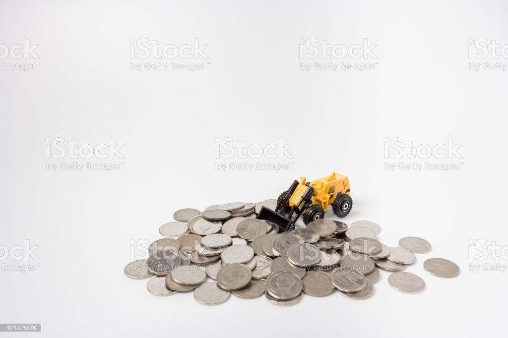 tractor toy raking up coins stock photo