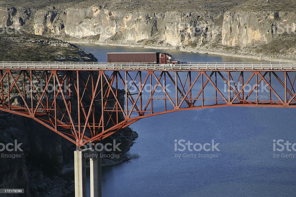tractor trailer and span bridge stock photo
