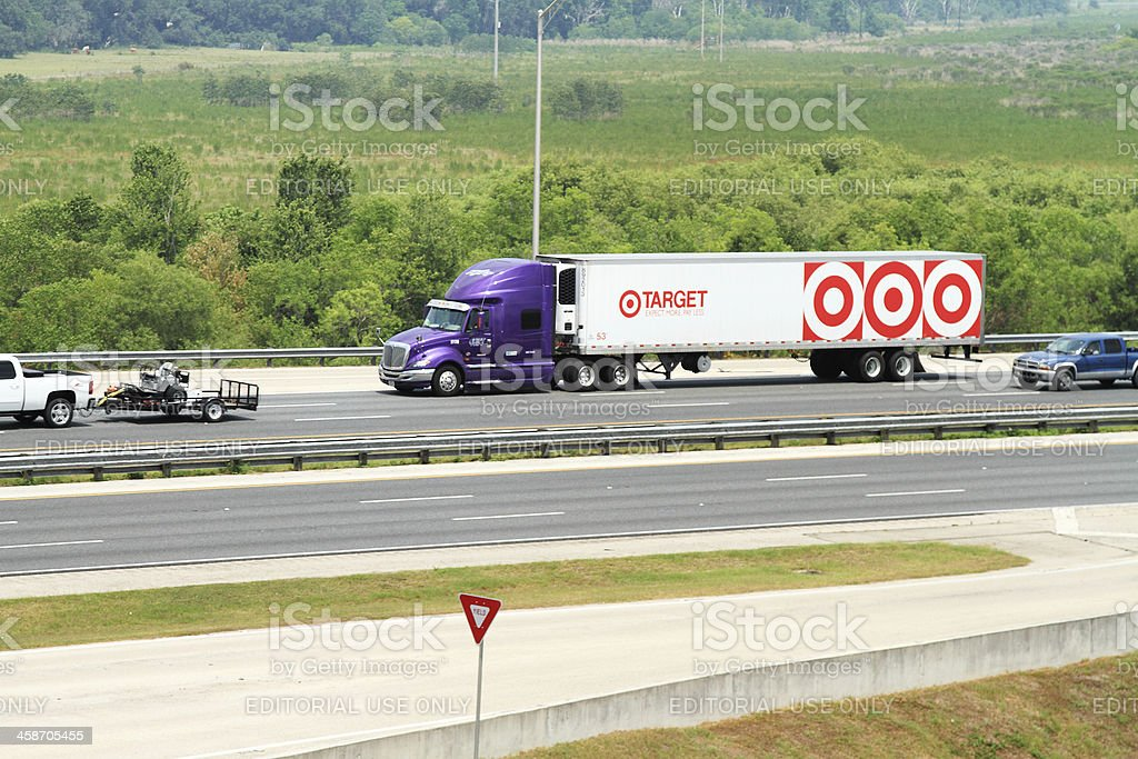 Tractor trailer hauling Target store mechandise on interstate highway royalty-free stock photo
