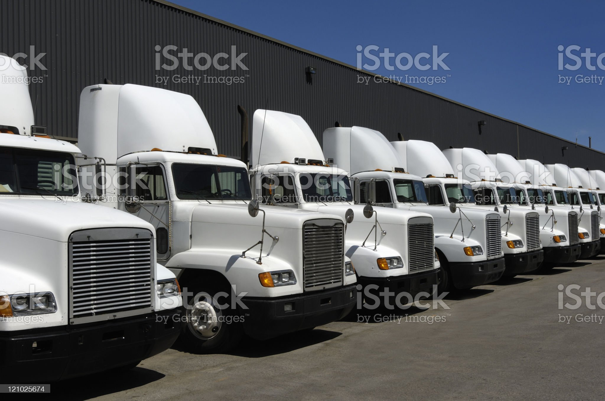Tractor trailers in line royalty-free stock photo