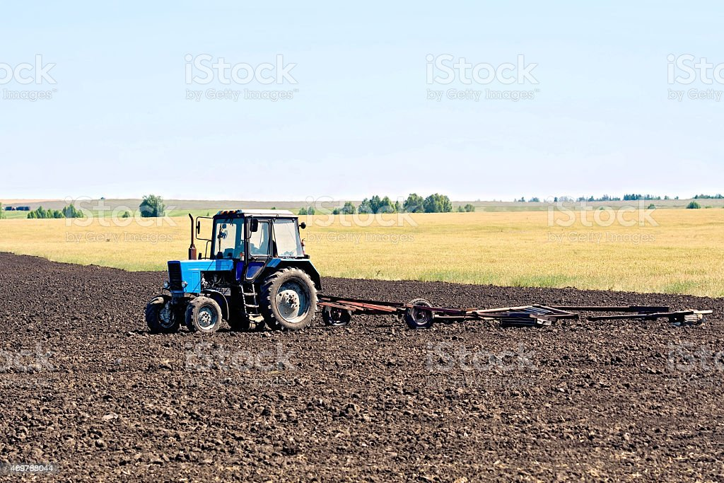 Tractor wheeled plowing stock photo