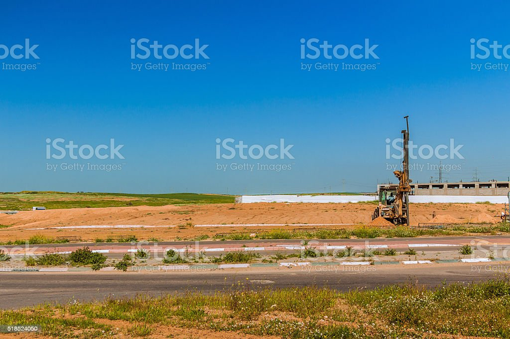 Tractor with a drilling device at a construction site stock photo