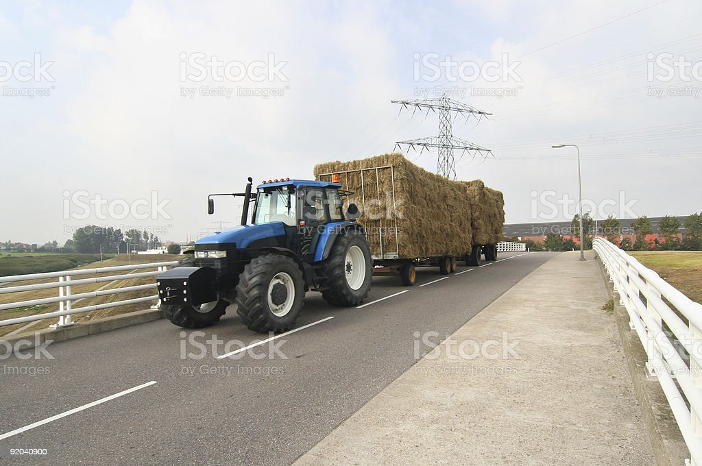 Tractor with hay wagon stock photo