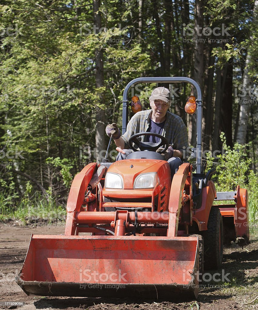 Tractor With Operator royalty-free stock photo