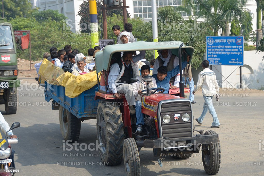 tractor with passengers royalty-free stock photo