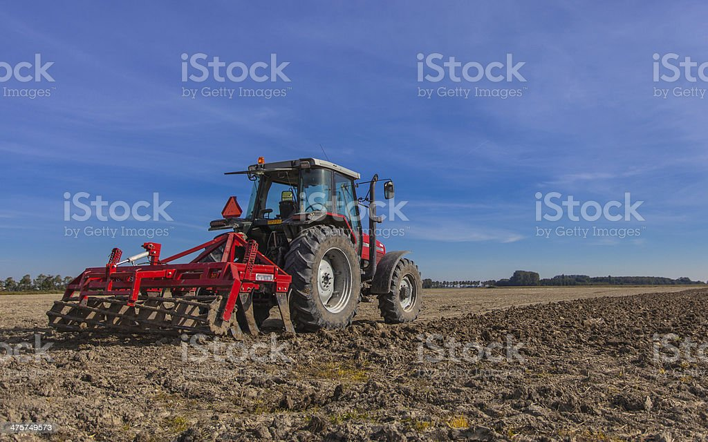 Tractor with Plough at Work stock photo