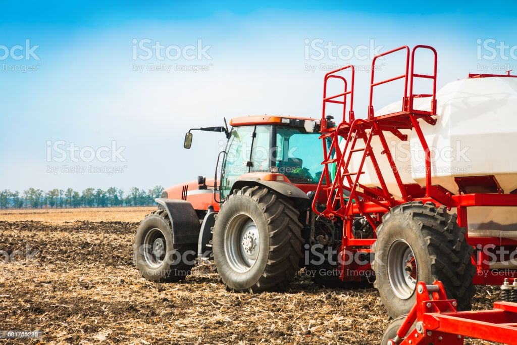 Tractor with tanks in the field. Agricultural machinery and farming. stock photo