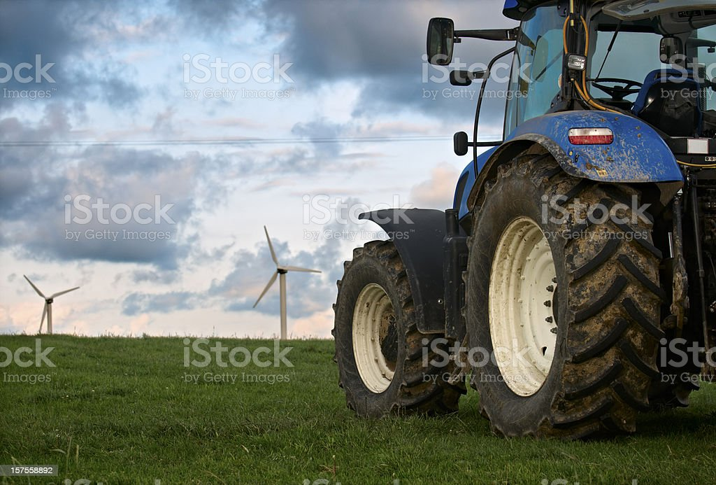 Tractor with wind farm turbines in Cornwall royalty-free stock photo