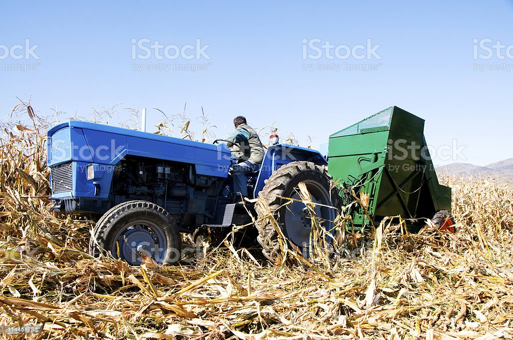 Tractor working on the field royalty-free stock photo