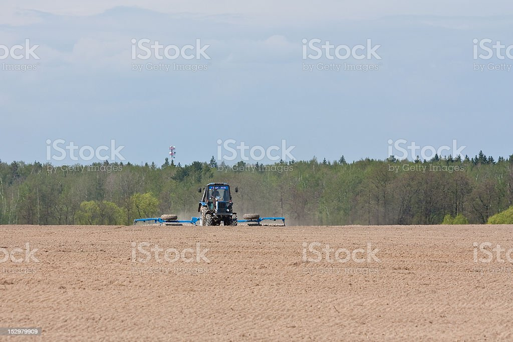 Tractor works in field royalty-free stock photo