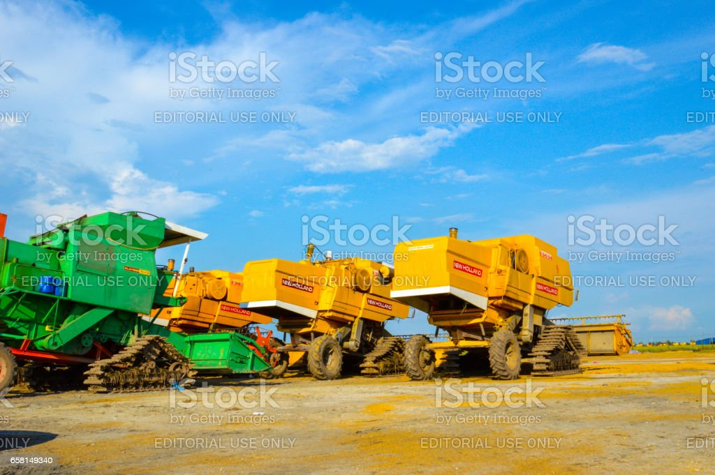 tractors and modern harvester combine. stock photo