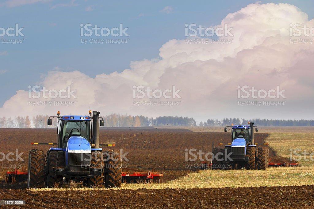Tractors planting farm fields stock photo
