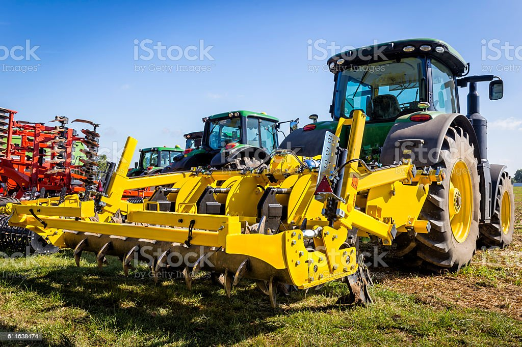 Tractors with seeding and plowing machine on the plantation stock photo