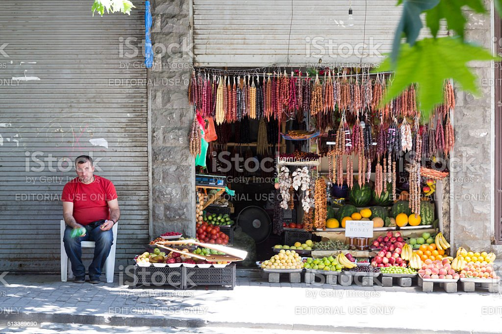 Trade in vegetables and sweets on the street stock photo