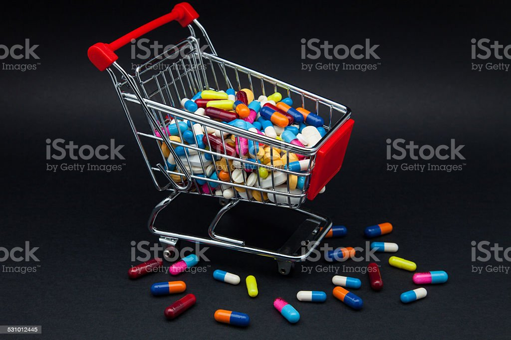 trade of pills and capsules stock photo