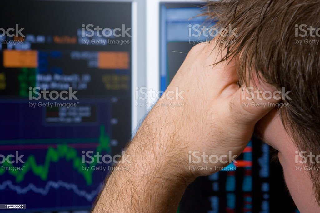 Trader concerned about his investment choices stock photo