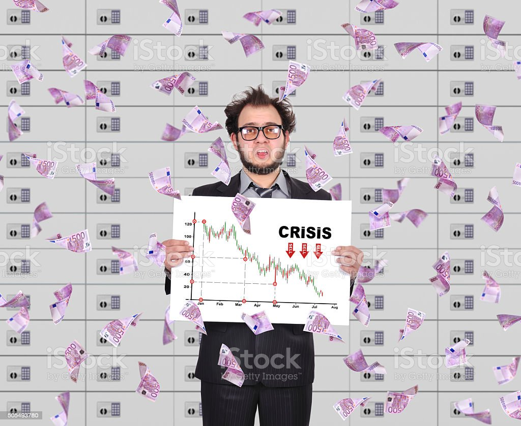 trader holding poster with crisis chart stock photo